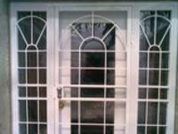 Decorative Storm Door aCathedral With Matching Side Lites 327
